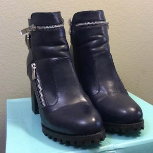Navy blue (silver zippers) 4 inch healed boots.